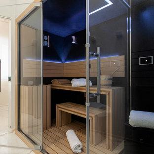 Foto di una sauna minimal con pareti nere e pavimento bianco