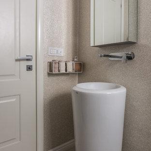 Ispirazione per una piccola stanza da bagno con doccia stile shabby con ante di vetro, ante bianche, piastrelle beige, doccia ad angolo, piastrelle in gres porcellanato, pareti beige, pavimento in marmo, lavabo a colonna, pavimento bianco, porta doccia a battente e WC monopezzo