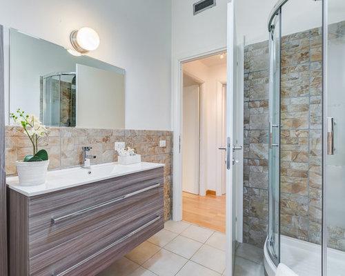 Bagno con piastrelle in pietra foto idee arredamento - Piastrelle pietra bagno ...