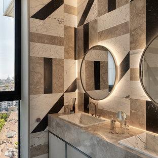 Idee per una stanza da bagno padronale minimal con ante lisce, ante beige, piastrelle multicolore, lavabo da incasso, pavimento multicolore e top grigio