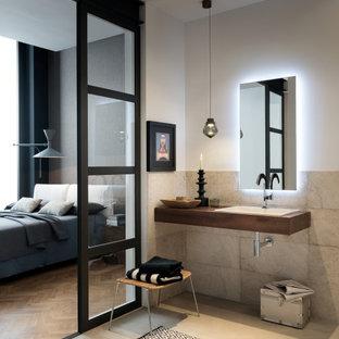 Ispirazione per una stanza da bagno con doccia design di medie dimensioni con piastrelle grigie, piastrelle in gres porcellanato, pareti bianche, pavimento in gres porcellanato, lavabo da incasso, pavimento grigio, top marrone e un lavabo