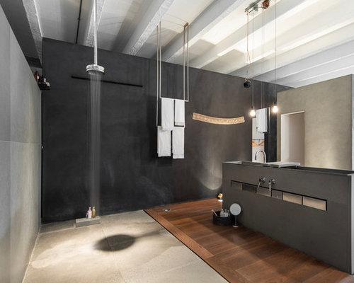 Stanza da bagno con piastrelle grigie e pareti nere foto idee
