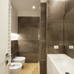 Example of a small minimalist 3/4 black tile and porcelain tile light wood floor, single-sink and tray ceiling walk-in shower design in Rome with flat-panel cabinets, white cabinets, a wall-mount toilet, white walls, a trough sink, solid surface countertops, a hinged shower door, white countertops, a niche and a floating vanity