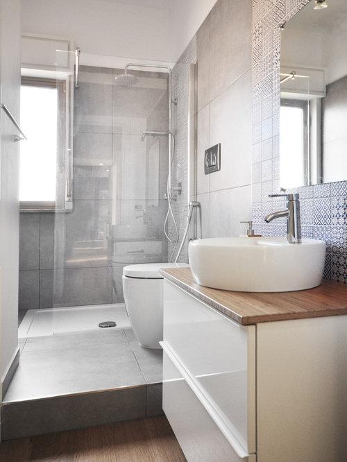 Foto e idee per stanze da bagno stanza da bagno con piastrelle grigie - Piastrelle da bagno moderne ...