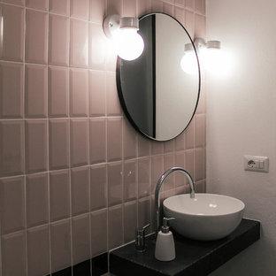Ispirazione per una piccola stanza da bagno mediterranea con nessun'anta, piastrelle rosa, piastrelle in ceramica, pareti bianche, pavimento in cemento, top in cemento, pavimento grigio, top nero, doccia alcova, lavabo a bacinella e porta doccia a battente