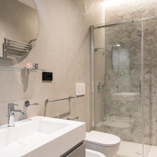 Ispirazione per una stanza da bagno con doccia minimal di medie dimensioni con ante lisce, ante grigie, doccia alcova, WC sospeso, piastrelle grigie, lavabo integrato, pavimento verde, porta doccia a battente, top bianco, un lavabo e mobile bagno sospeso