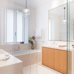 Immagine di una stanza da bagno padronale design con ante lisce, ante in legno scuro, vasca sottopiano, piastrelle beige, pareti bianche, lavabo integrato, pavimento beige, doccia aperta e top beige