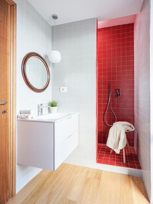 Example Of A Small Trendy 3/4 Red Tile Light Wood Floor And Beige Floor
