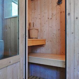 Esempio di una piccola sauna scandinava con doccia doppia, pavimento in mattoni, pavimento rosa e porta doccia scorrevole