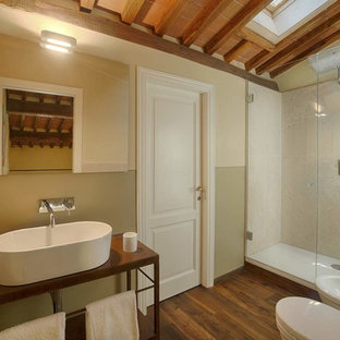 Inspiration for a contemporary bathroom in Venice with open cabinets, brown cabinets, a corner shower, a bidet, beige tile, beige walls, medium hardwood floors, a vessel sink, brown floor, a hinged shower door and brown benchtops.