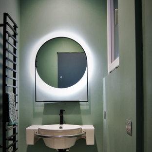 Esempio di una piccola stanza da bagno con doccia contemporanea con ante bianche, pareti verdi, lavabo sospeso, top bianco e un lavabo