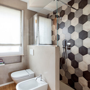Walk-in shower - eclectic black and white tile and gray tile medium tone wood floor walk-in shower idea in Other with a two-piece toilet and gray walls