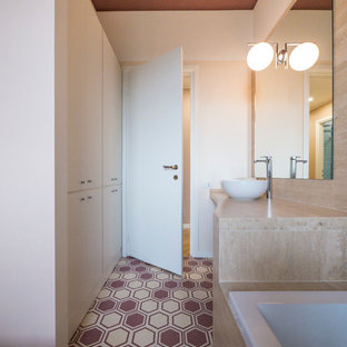 Design ideas for a medium sized contemporary ensuite bathroom in Milan with flat-panel cabinets, beige cabinets, a built-in bath, a shower/bath combination, multi-coloured tiles, porcelain tiles, beige walls, a vessel sink and marble worktops.
