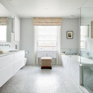 Ispirazione per una stanza da bagno padronale design con ante lisce, ante bianche, vasca sottopiano, pareti bianche, pavimento con piastrelle a mosaico, lavabo sottopiano, pavimento multicolore, top bianco, due lavabi e mobile bagno sospeso