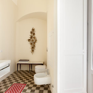 Design ideas for a medium sized mediterranean bathroom in Milan with white cabinets, a wall mounted toilet, white walls, terracotta flooring and a trough sink.