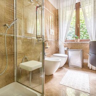 Идея дизайна: ванная комната среднего размера в классическом стиле с плоскими фасадами, коричневыми фасадами, угловым душем, плиткой из листового камня, мраморным полом, душевой кабиной, стеклянной столешницей и душем с распашными дверями