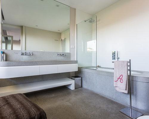 Stanza da bagno con pavimento in cemento foto idee - Vasca da bagno in cemento ...