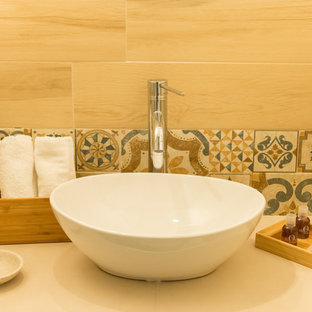 Small mediterranean shower room in Other with open cabinets, white cabinets, a corner bath, a built-in shower, a two-piece toilet, beige tiles, porcelain tiles, white walls, porcelain flooring, a vessel sink, wooden worktops, beige floors and a hinged door.