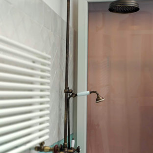 This is an example of a medium sized mediterranean shower room bathroom in Rome with louvered cabinets, beige cabinets, a walk-in shower, a one-piece toilet, multi-coloured tiles, ceramic tiles, multi-coloured walls, ceramic flooring, a vessel sink, wooden worktops, beige floors, a sliding door, brown worktops, a single sink and a freestanding vanity unit.