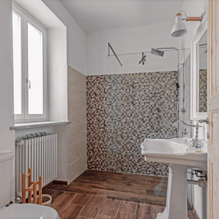 Mediterranean shower room in Other with a built-in shower, beige tiles, grey tiles, mosaic tiles, white walls, a pedestal sink, brown floors and an open shower.