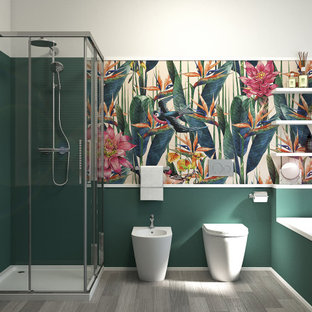 Photo of a small modern 3/4 bathroom in Milan with flat-panel cabinets, white cabinets, a drop-in tub, a corner shower, a one-piece toilet, green tile, green walls, linoleum floors, a drop-in sink, engineered quartz benchtops, beige floor, a sliding shower screen, white benchtops, a single vanity, a floating vanity and wallpaper.