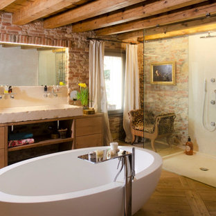 Bathroom - eclectic master medium tone wood floor, single-sink, exposed beam and brick wall bathroom idea in Venice with flat-panel cabinets, light wood cabinets, a vessel sink, wood countertops, a hinged shower door and a freestanding vanity