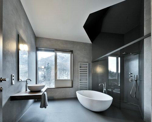 Stanza da bagno con pavimento in cemento foto idee - Bagno in camera moderno ...