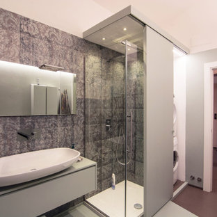 This is an example of a large contemporary 3/4 bathroom in Florence with flat-panel cabinets, green cabinets, a double shower, a two-piece toilet, green tile, green walls, concrete floors, a vessel sink, concrete benchtops, green floor, a sliding shower screen and turquoise benchtops.