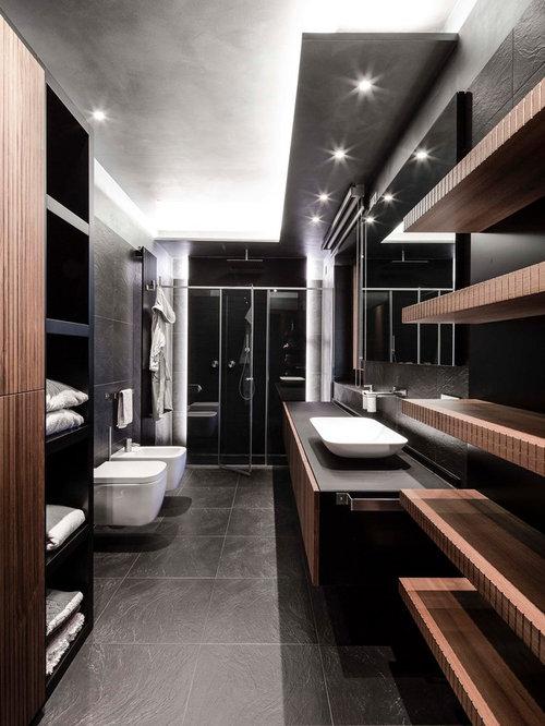 Foto e idee per stanze da bagno stanza da bagno con - Piastrelle nere per bagno ...