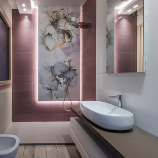 Contemporary shower room bathroom in Other with open cabinets, a walk-in shower, a bidet, pink tiles, white walls, medium hardwood flooring, a vessel sink, grey floors, an open shower and grey worktops.
