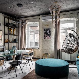 На фото: столовая в стиле лофт с белыми стенами, серым полом и кирпичными стенами