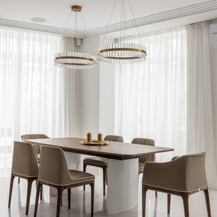 Стильный дизайн: столовая в современном стиле с белыми стенами и белым полом - последний тренд