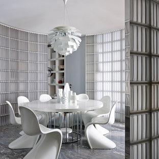 Неиссякаемый источник вдохновения для домашнего уюта: столовая в современном стиле с серым полом