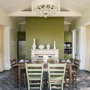 Удачное сочетание для дизайна помещения: столовая среднего размера в классическом стиле с зелеными стенами, полом из керамической плитки, камином и разноцветным полом - самое интересное для вас
