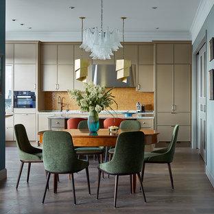 На фото: гостиные-столовые в современном стиле с синими стенами и темным паркетным полом