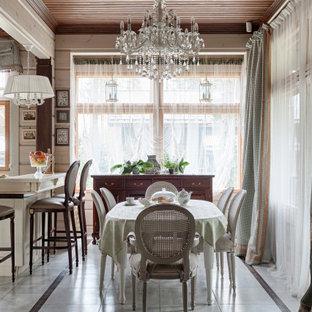 На фото: кухня-столовая среднего размера в стиле кантри с серым полом и бежевыми стенами с