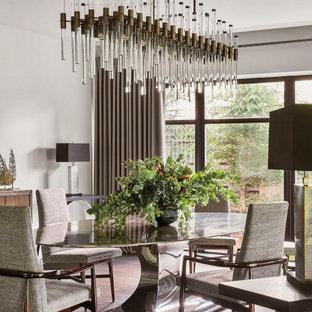 На фото: большие столовые в современном стиле с белыми стенами, паркетным полом среднего тона и коричневым полом без камина