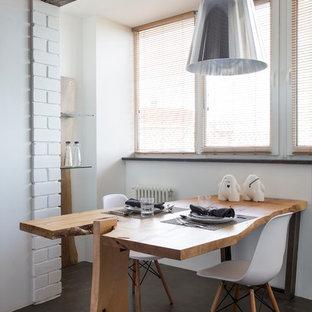 Foto di una sala da pranzo aperta verso il soggiorno industriale con pareti bianche e pavimento nero