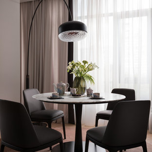 Inspiration for a contemporary carpeted and pink floor dining room remodel in Other with purple walls