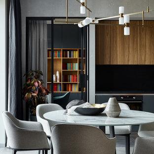 Удачное сочетание для дизайна помещения: кухня-столовая в современном стиле с серыми стенами и серым полом - самое интересное для вас