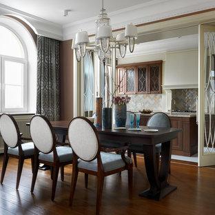 На фото: отдельная столовая среднего размера в стиле современная классика с коричневыми стенами, паркетным полом среднего тона и коричневым полом без камина