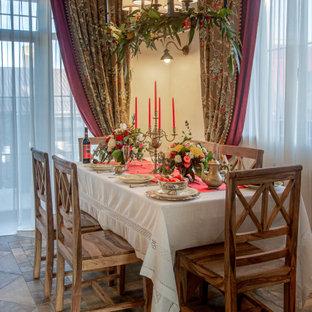 Inspiration för ett mellanstort rustikt kök med matplats, med vita väggar, klinkergolv i porslin, en bred öppen spis och grått golv