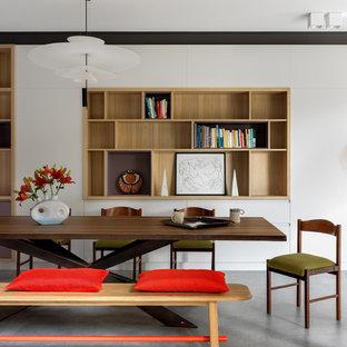 Пример оригинального дизайна: столовая в современном стиле с белыми стенами, серым полом и бетонным полом