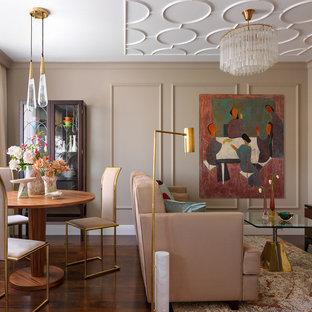 На фото: гостиная-столовая в стиле неоклассика (современная классика) с бежевыми стенами, темным паркетным полом и коричневым полом