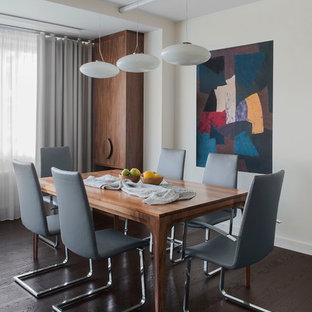 Создайте стильный интерьер: гостиная-столовая в современном стиле с белыми стенами и темным паркетным полом - последний тренд