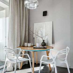 На фото: кухня-столовая в современном стиле с серыми стенами и черным полом с