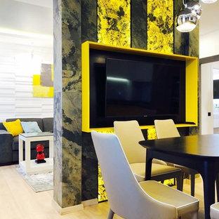 Пример оригинального дизайна: столовая среднего размера в современном стиле с желтыми стенами