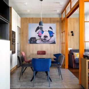 На фото: гостиная-столовая в стиле лофт с серыми стенами и серым полом с