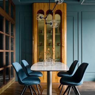 На фото: столовая в современном стиле с коричневыми стенами, темным паркетным полом, коричневым полом, кессонным потолком и панелями на части стены