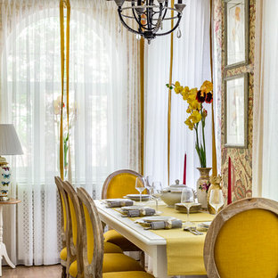 Design ideas for a small transitional separate dining room in Moscow with yellow walls, medium hardwood floors and beige floor.